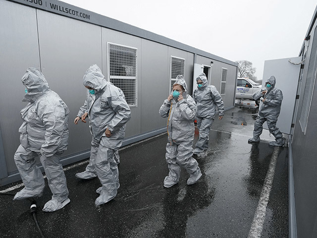 Test Center, people leaving a mobile office trailer in protective suits
